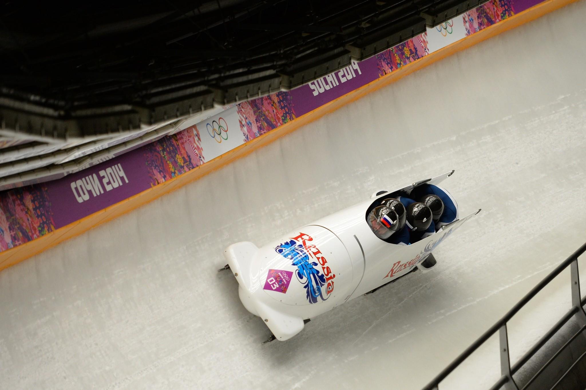 Russia-1 four-man bobsleigh, pilot Alexander Zubkov, pushman Alexey Negodaylo, pushman Dmitry Trunenkov and brakeman Alexey Voevoda compete in the Bobsleigh Four-man Heat 2 at the Sanki Sliding Center during the Sochi Winter Olympics on February 22, 2014.