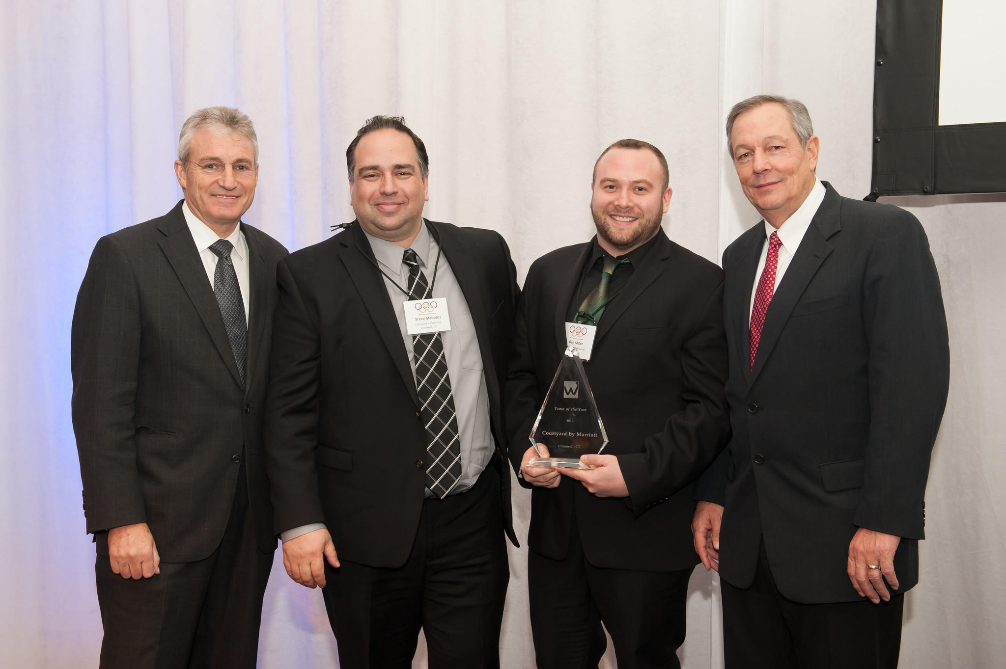From left to right: Len Wolman, chairman & CEO, Waterford Group; Steve Matiatos, general manager, Courtyard Marriott Cromwell; Dan Miller, director of Sales, Courtyard Marriott Cromwell; and Rob Winchester, president & COO, Waterford Hotel Group.
