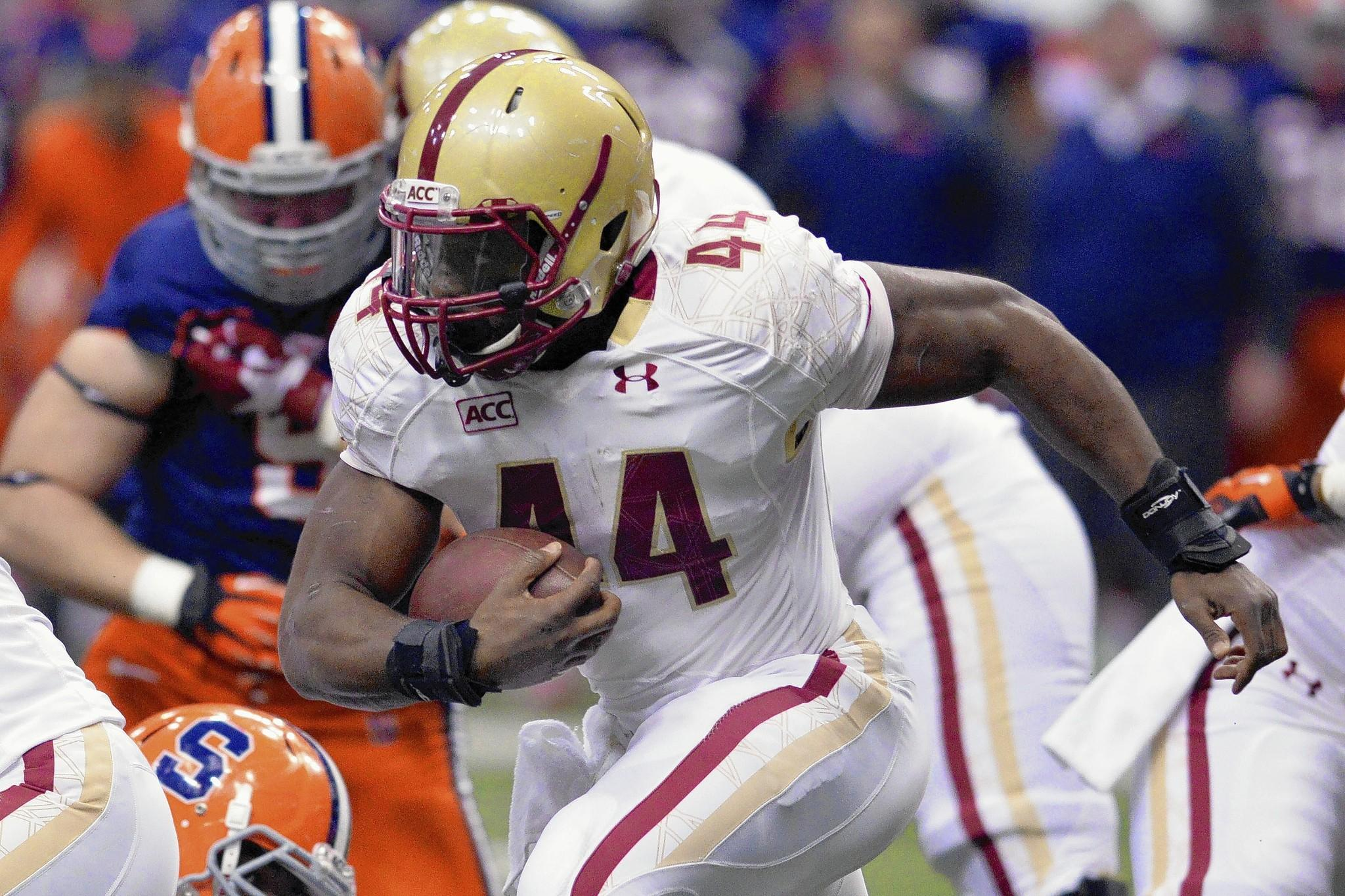 Nov 30, 2013; Syracuse, NY, USA; Boston College Eagles running back Andre Williams (44) runs behind the line of scrimmage during the first quarter of a game against the Syracuse Orange at the Carrier Dome.