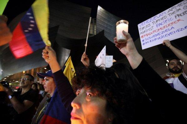 Demonstrators gathered Friday outside Disney Hall to hold a vigil for Venezuela, the native country of L.A. Phil conductor Gustavo Dudamel. (Michael Robinson Chavez / Los Angeles Times)