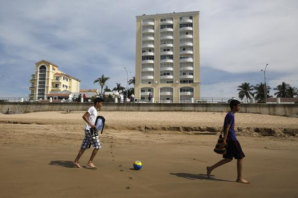 "Locals play on the beach in front of the condominium complex where Sinaloa cartel leader Joaquin ""El Chapo"" Guzman was captured."