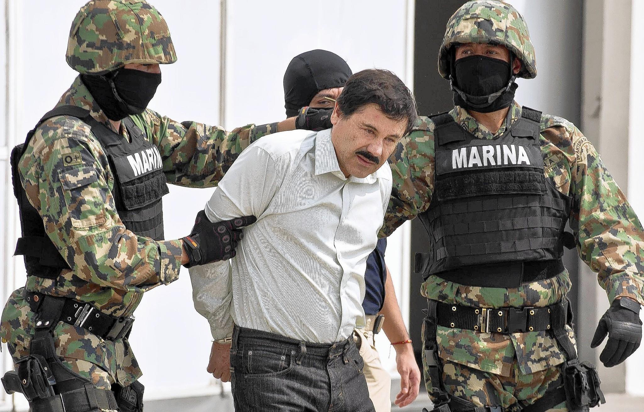 """Mexican drug trafficker Joaquin """"El Chapo"""" Guzman is paraded in front of the media by Mexican marines in Mexico City. The Sinaloa cartel leader, Mexico's most-wanted fugitive, was arrested at a condominium in Mazatlan."""