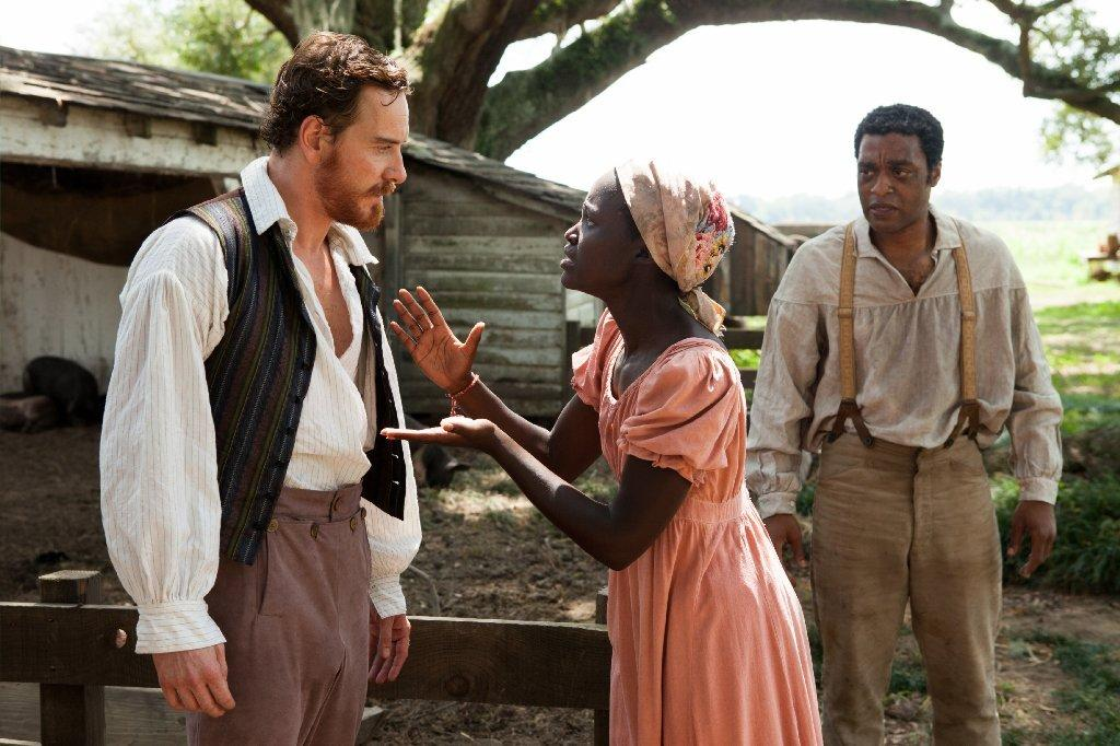 """12 Years a Slave"" picked up several 2014 NAACP Image Awards, including ones for director Steve McQueen and supporting actress Lupita Nyong'o, pictured here in a scene with Michael Fassbender, left, and Chewitel Ejiofor."