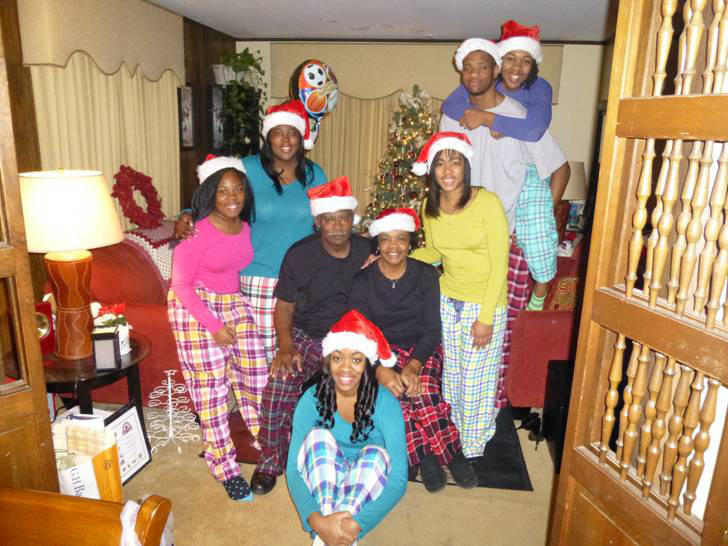 Damonte Dodd, back right, is pictured in this Christmas Day photo with the family of Natasha Wright, standing in front of him, a special education math teacher at Queen Anne's County High who became like a surrogate mother to him.
