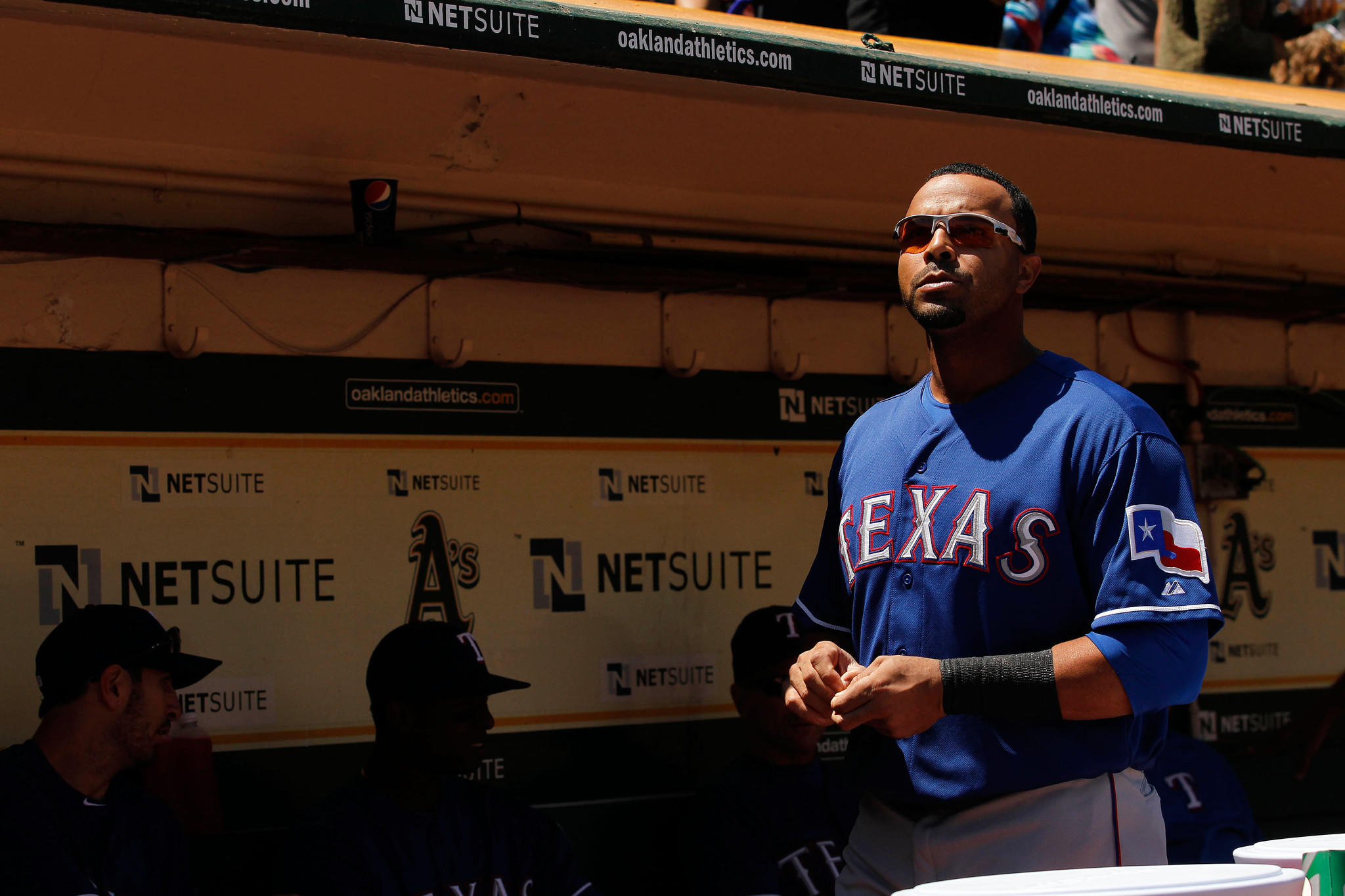 Outfielder Nelson Cruz looks on from the dugout before the start of a Texas Rangers game last season. Cruz agreed to a one-year deal with the Orioles on Saturday, according to industry sources.