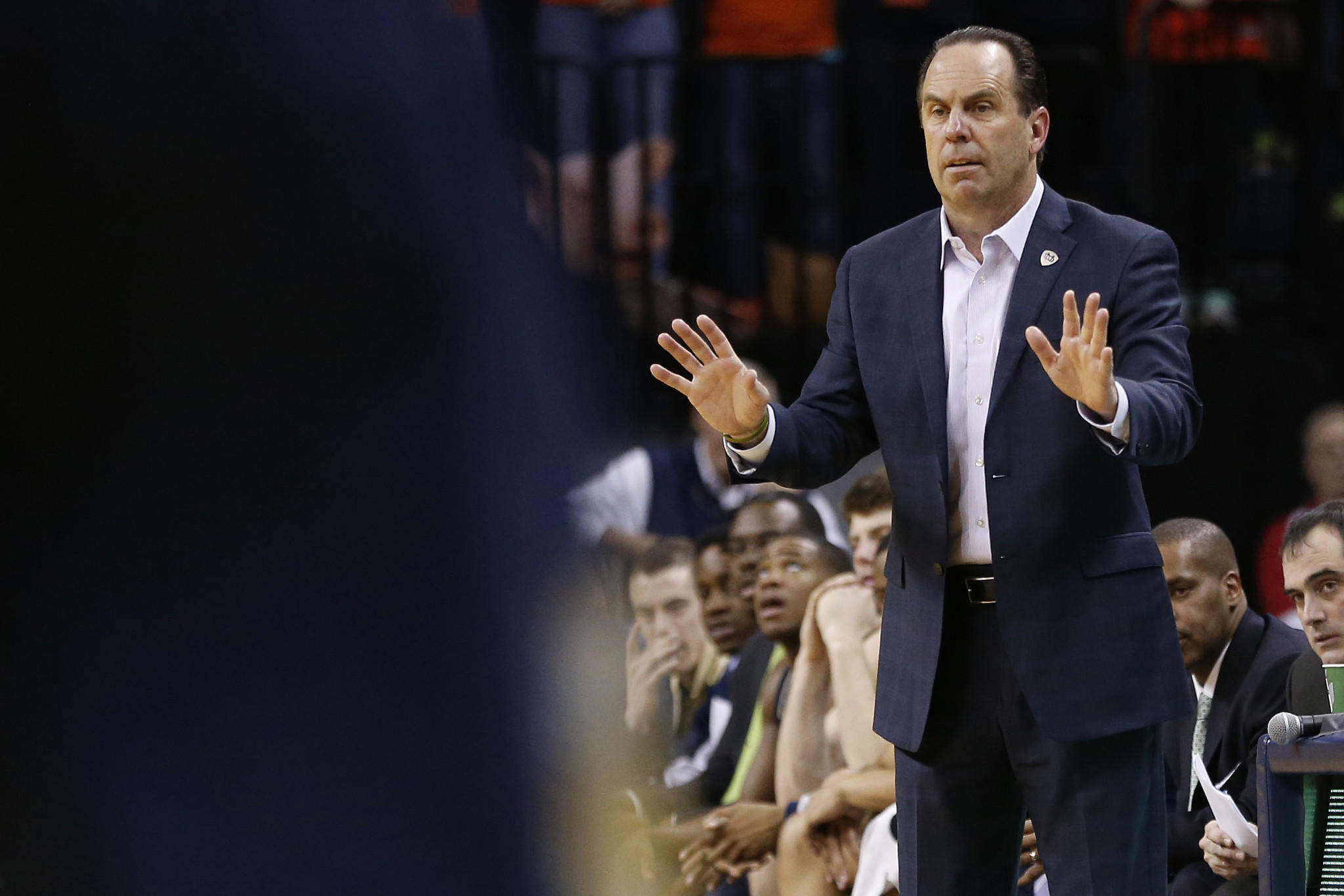 Notre Dame coach Mike Brey gestures from the sidelines against Virginia.