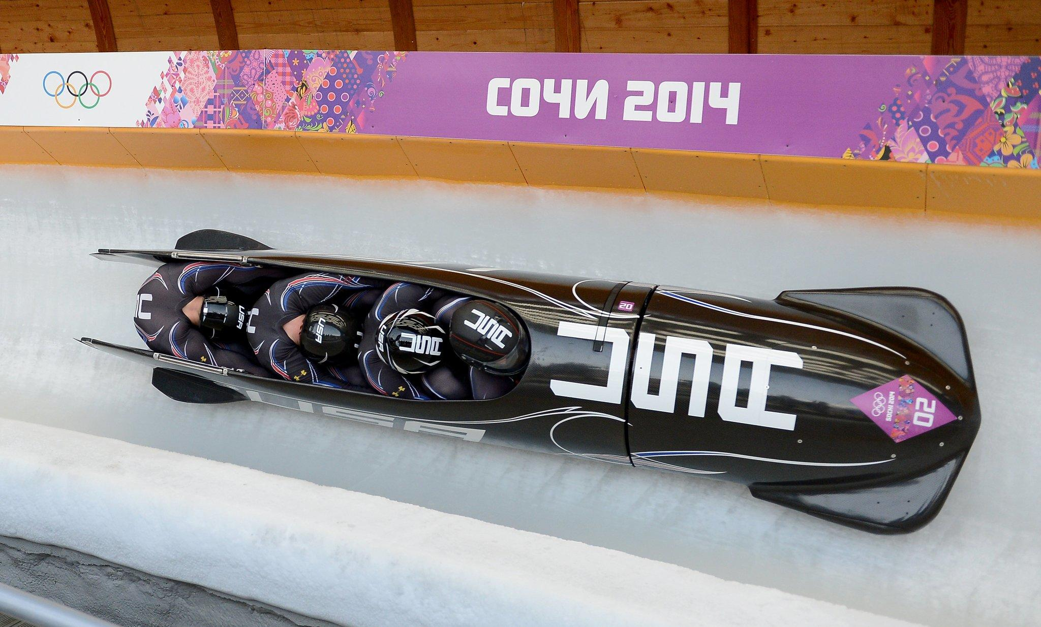 The USA 2 bobsled competes during the third heat of the four-man bobsled event at the Sanki Sliding Centre during the Winter Olympics in Sochi, Russia, Sunday, Feb. 23, 2014. The USA 2 team, Steven Holcomb, Curtis Tomasevicz, Steven Langton and Christopher Fogt, won the bronze medal in the event.