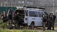 U.S.-born killer shoots guards, is slain in Israeli prison