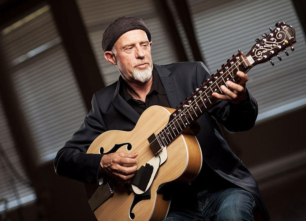 Harry Manx plays his signature instrument, a unique Indian guitar, that was stolen Friday at O'Hare International Airport.