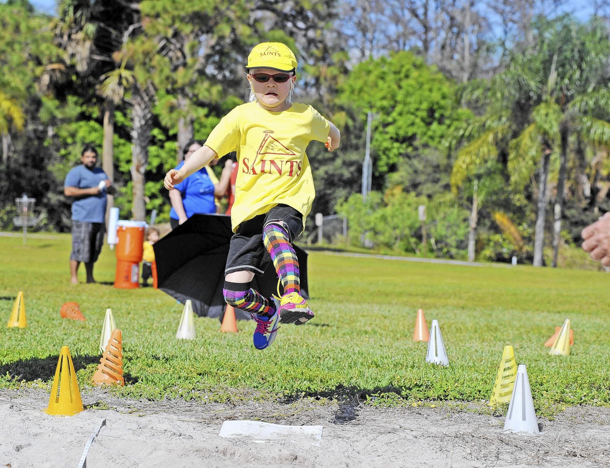 Dania Beach's Mae Li Wilcox does the running broad jump during the annual Saints International Track and Field meet for home schoolers recently at Tradewinds Park in Coconut Creek. Wilcox, who is legally blind, was one of an estimated 1,300 participants from Broward and Palm Beach counties.