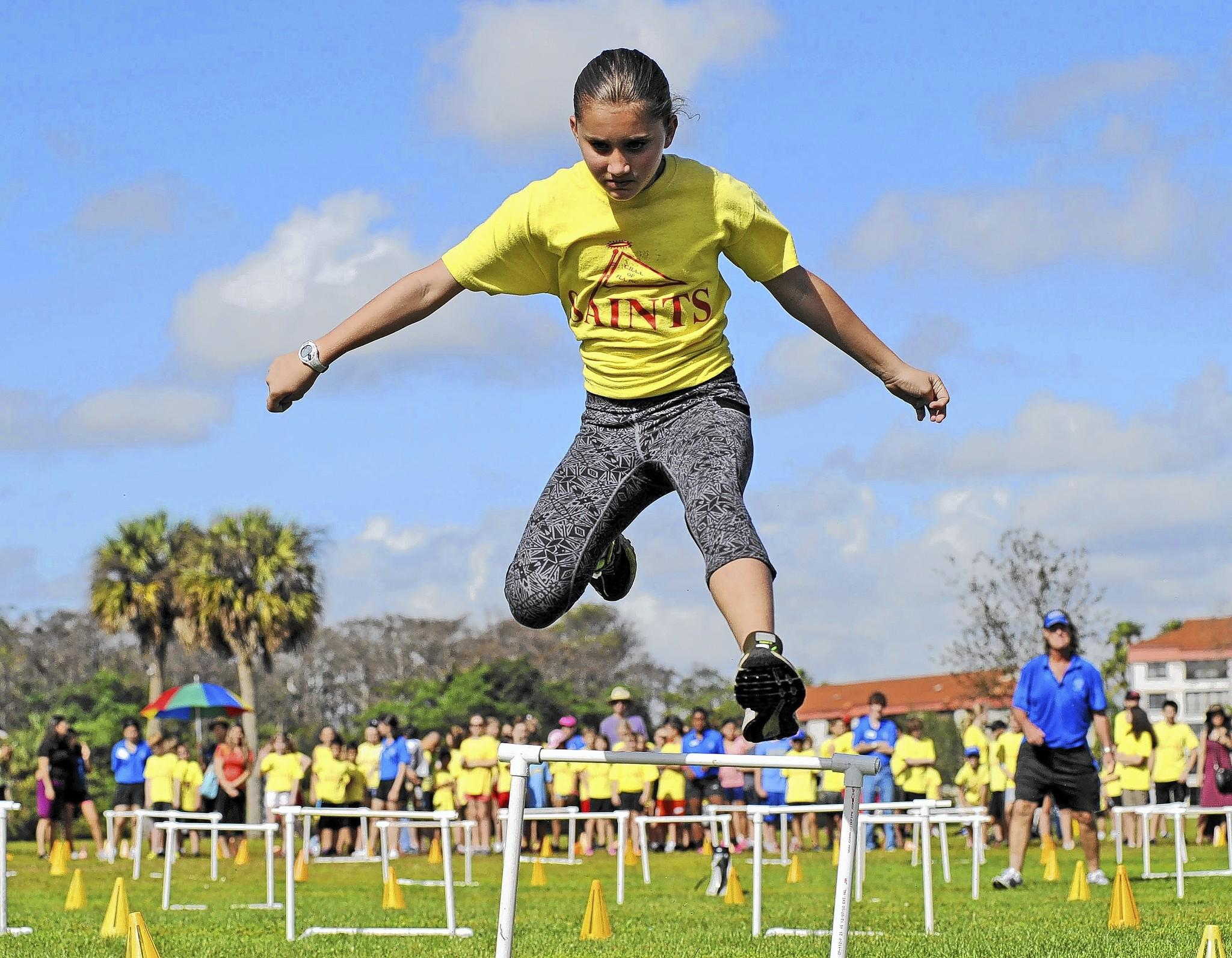 Boca Raton's Katherine Bielec soars over a hurdle during the annual Saints International Track and Field meet for home schoolers recently at Tradewinds Park in Coconut Creek. Bielec was one of an estimated 1,300 participants from Palm Beach and Broward counties.