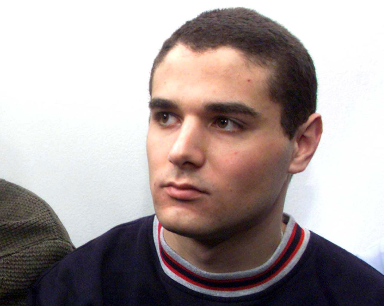 U.S. Jewish teenager Samuel Sheinbein, 18, arrives at the Tel Aviv District Court in this March 22, 1999 file photo. Israeli police shot dead American-Israeli prisoner Sheinbein on February 23, 2014 after he wounded three guards with a pistol at a jail near Tel Aviv, police said. Police spokesman Micky Rosenfeld said Sheinbein, serving a 24-year sentence for a 1997 Maryland murder, had shot the three security officers, leaving one critically injured.