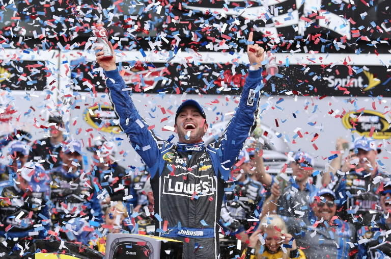 Jimmie Johnson celebrates in Victory Lane after winning the 2013 Daytona 500. Viewers on Sunday thought he had repeated as they watched Fox's replay of last year's race during the rain delay. (Stephen M. Dowell/Orlando Sentinel)