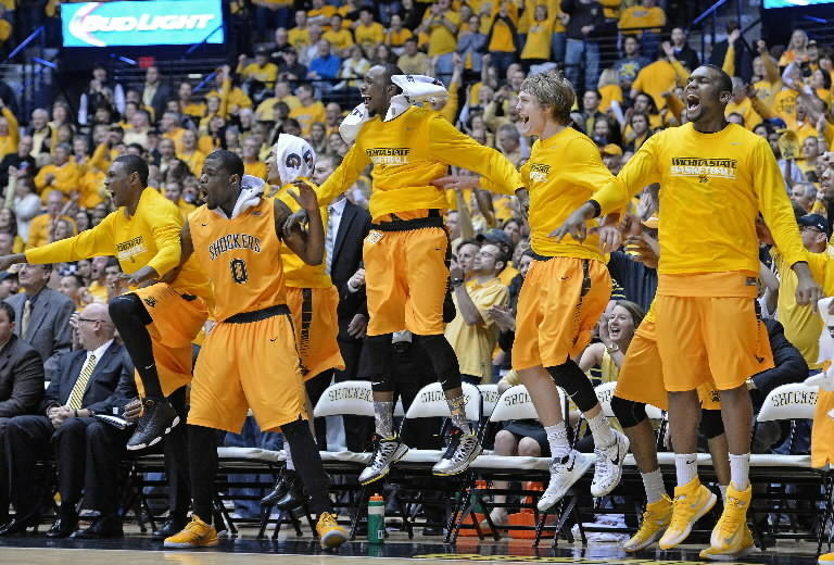 The Wichita State Shockers bench celebrates after defeating the Drake Bulldogs to win the Missouri Valley Conference on February 22, 2014 at Charles Koch Arena. Wichita State won 83-54. (Photo by Peter Aiken/Getty Images)