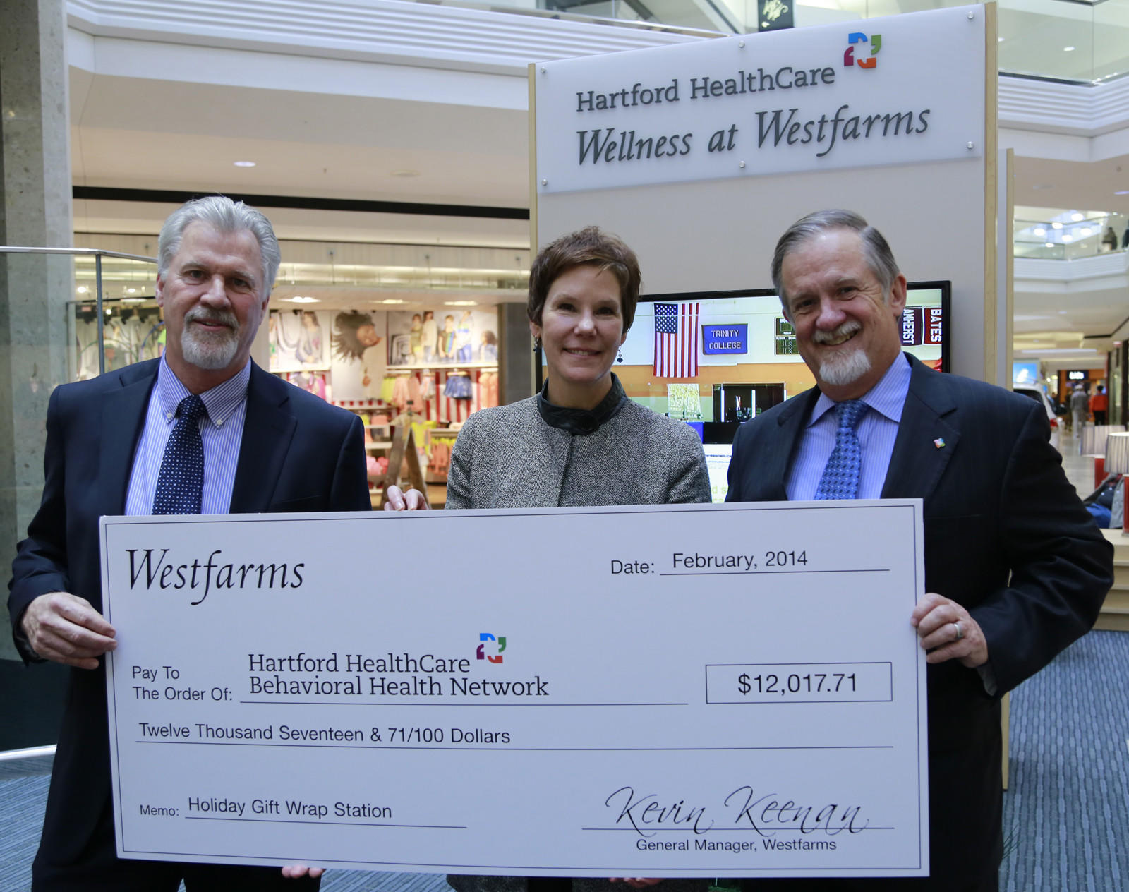HHC BHN Senior Vice President Stephen W. Larcen, PhD., right, accepts a check for the donation from Westfarms General Manager Kevin Keenan and Westfarms Marketing and Sponsorship Director Sarah Williams.