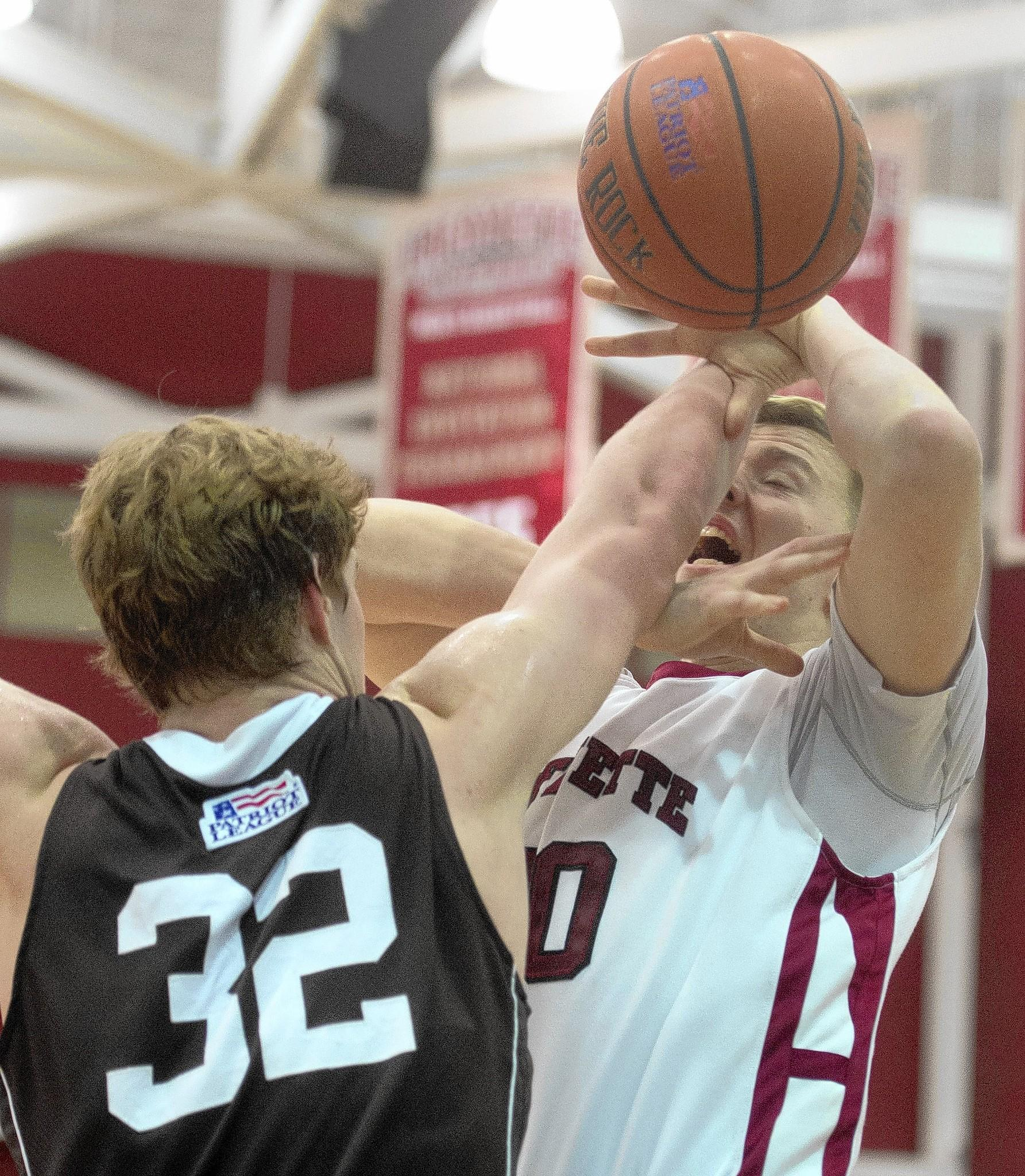 Lafayette's Dan Trist (right) and Lehigh's Tim Kempton get tangled at Lafayette College in Easton on Sunday. The Leopards won 77-71.