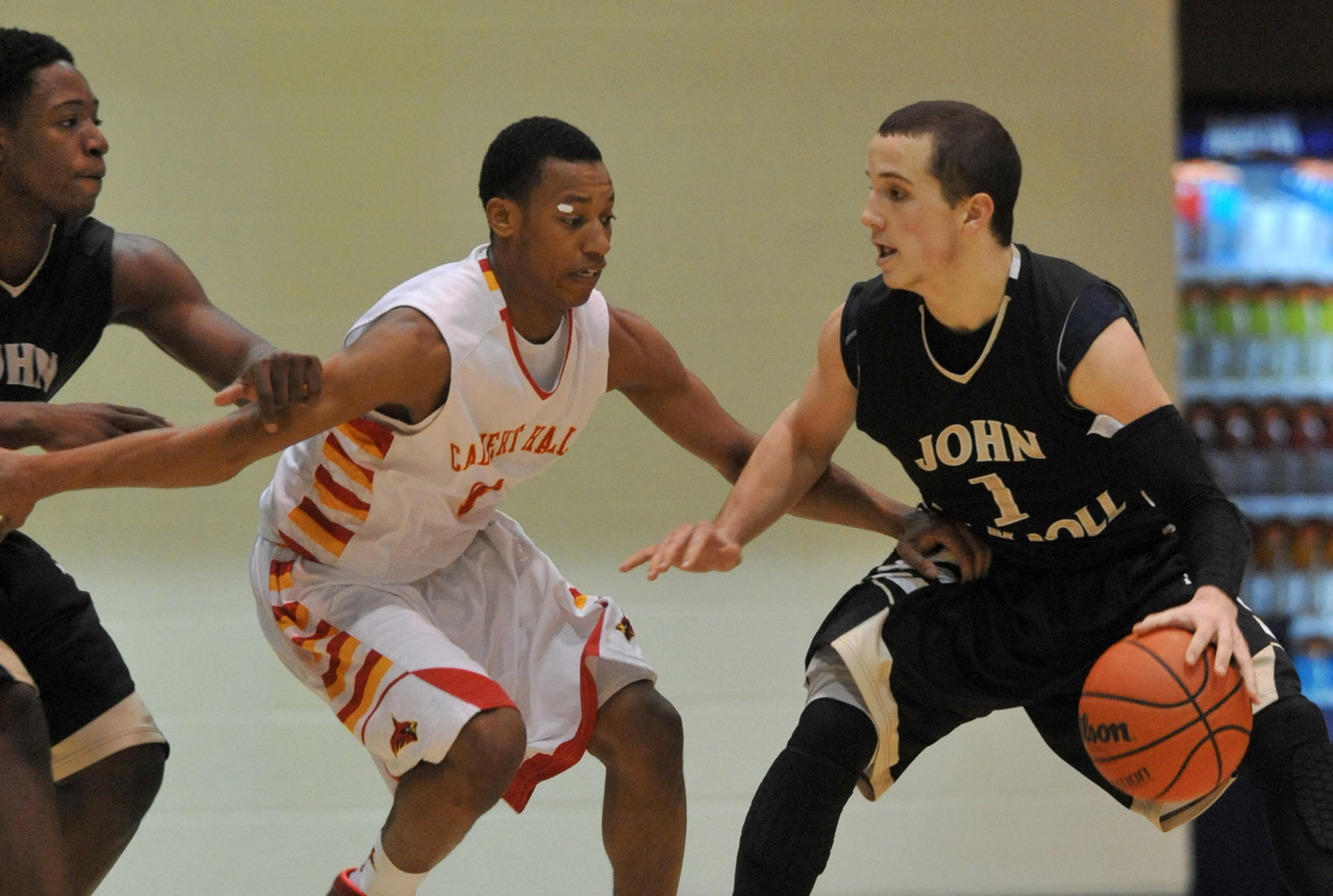 Calvert Hall's Sean Mayberry plays defense against Kimball Mackenzie as he drives toward the basket.