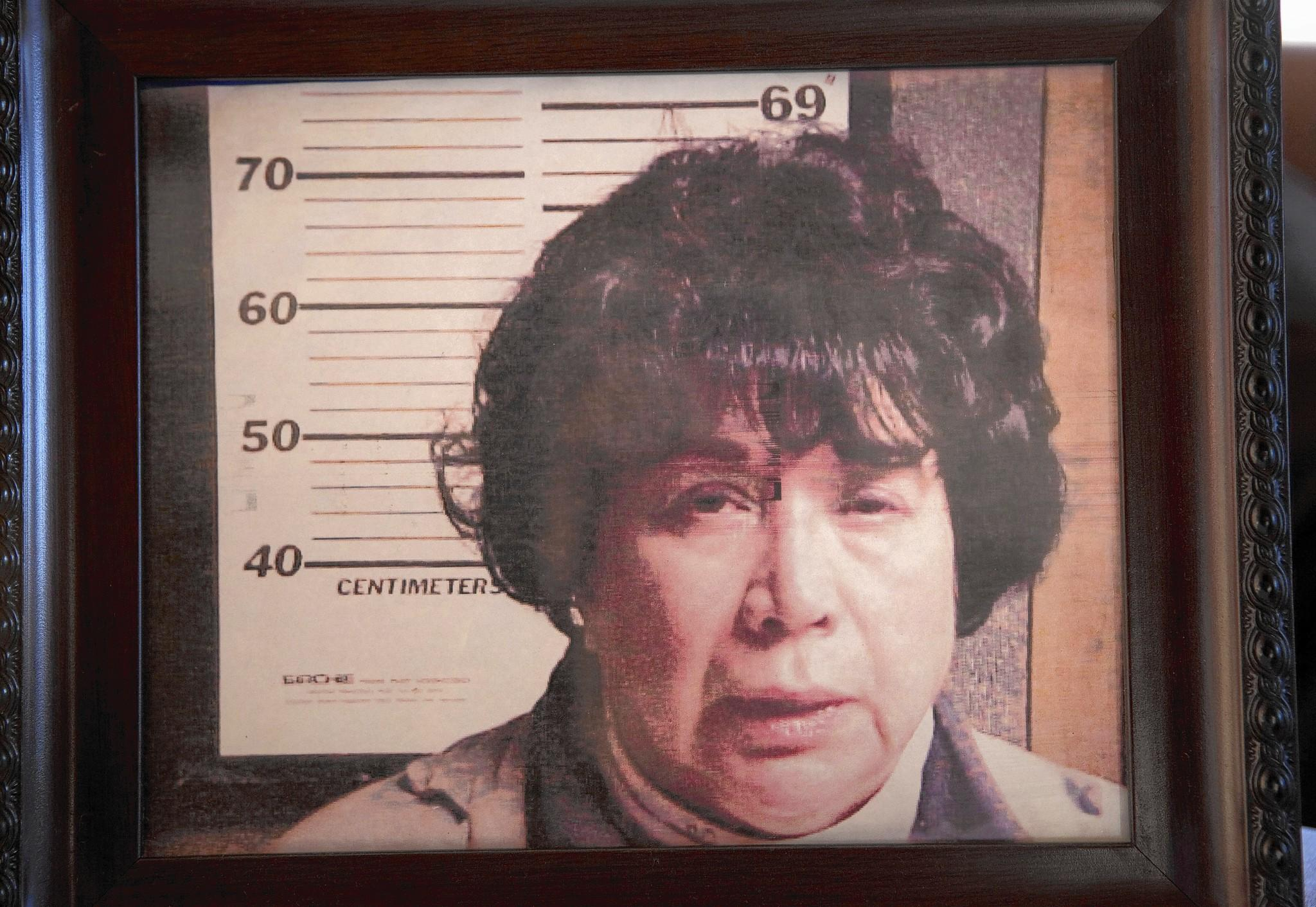 Homeowner John Hosta confronted tenant Marion Berntsen with her Fontana, Wis., police mug shot that he hung in his house where she could see it.