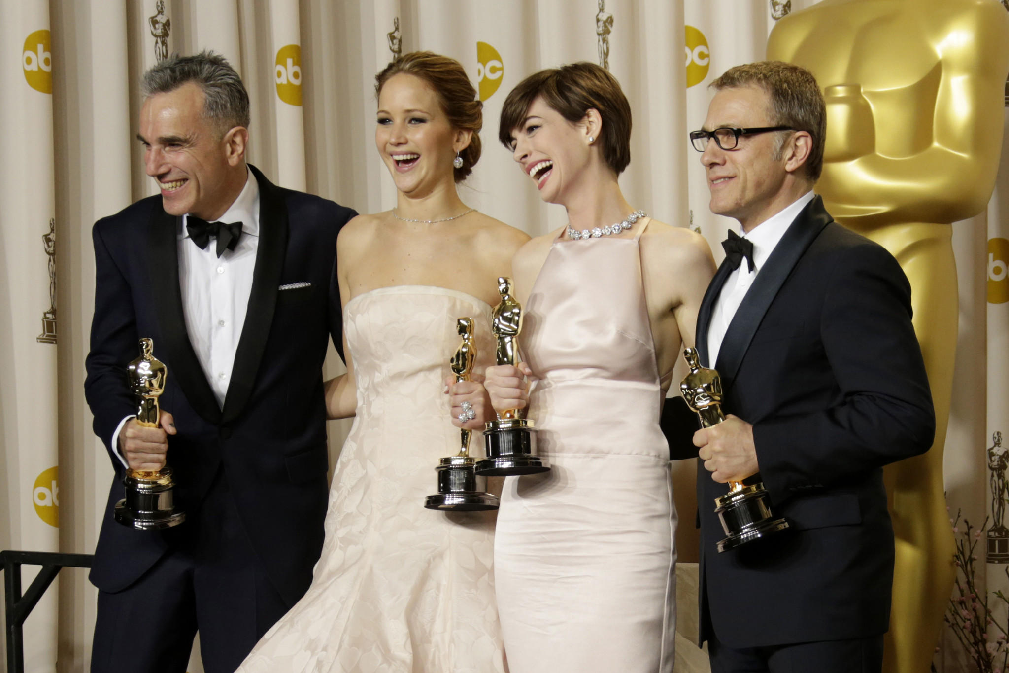 From left, Daniel Day-Lewis, Jennifer Lawrence, Anne Hathaway and Christoph Waltz backstage at the 85th annual Academy Awards.