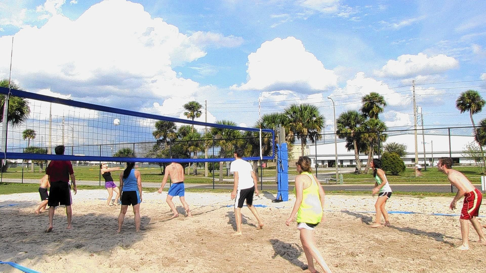 Groups gather for friendly games of beach volleyball on Sundays at Orlando's Festival Park.