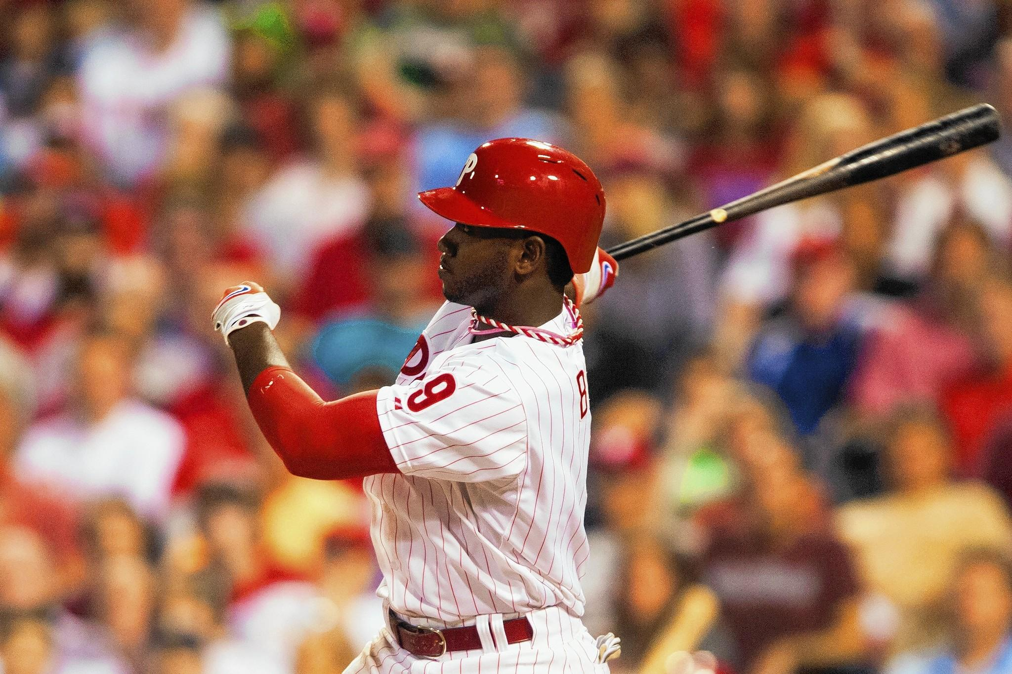 Philadelphia Phillies left fielder Domonic Brown hits a home run during a game last season.