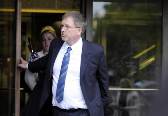 Former Windsor Locks Police Sgt. Robert Koistinen leaves Hartford Superior Court on Oct. 10, 2012, after being acquitted of hindering prosecution in a fatal crash involving his son, Michael, also a Windsor Locks police officer.