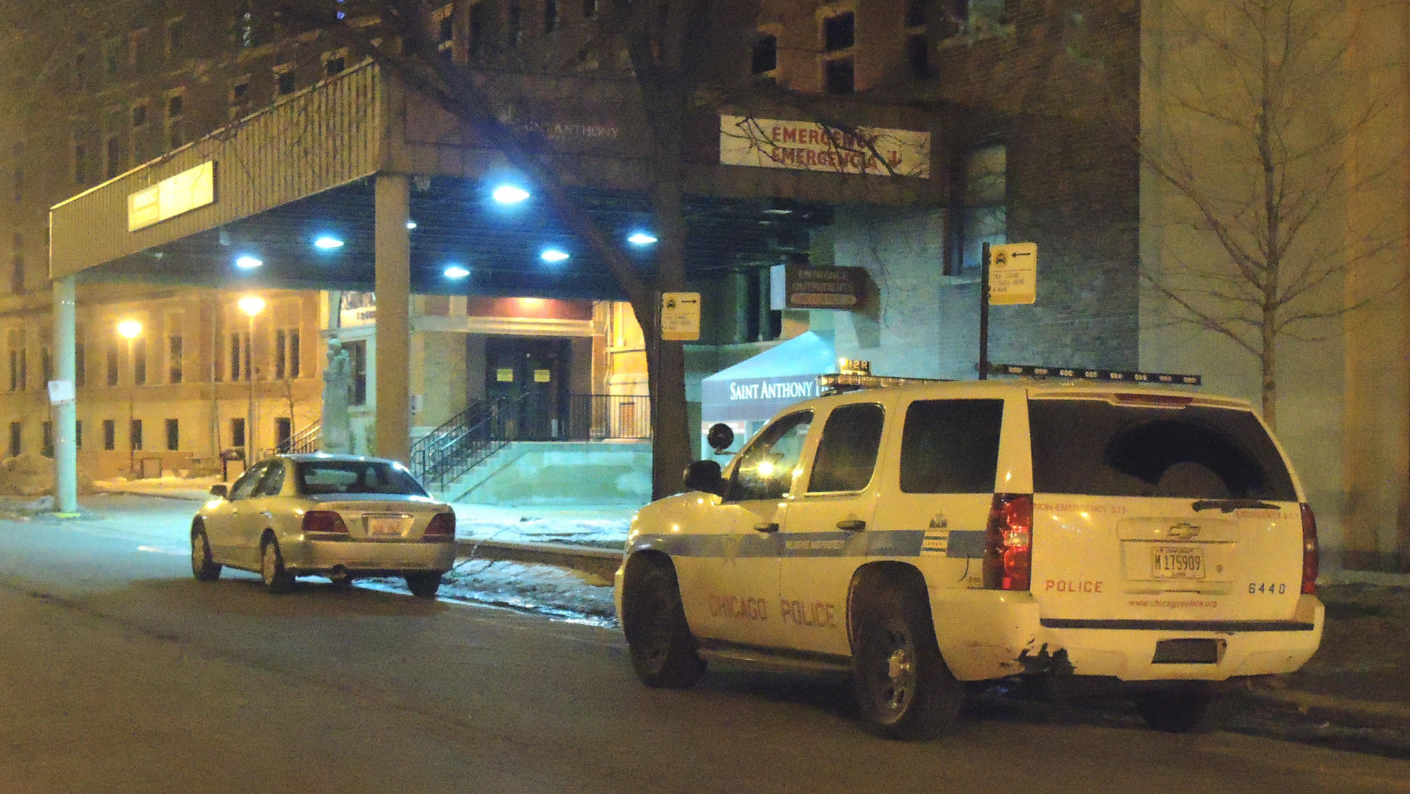 Police outside Saint Anthony Hospital, where a 16-year-old boy was brought after suffering a gunshot wound to his leg.