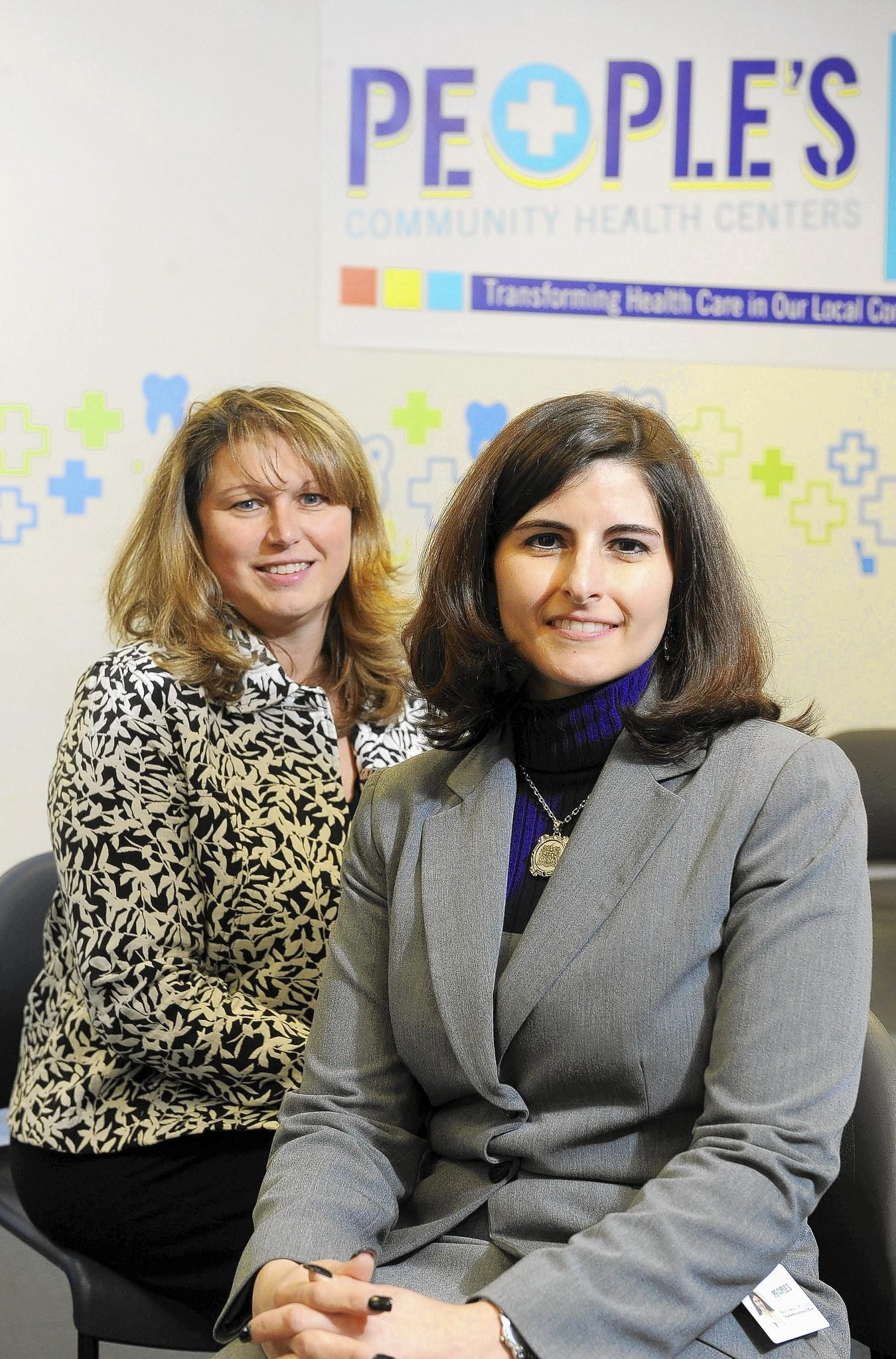 People's Community Health Centers will be opening a combination health and community center in the Pioneer City area next to Van Bokkelen Elementary School in Severn. Suzanne Bates-Crandall, left, Business Development and Community Relations, and Stacy Fruhling, Chief Administrative Officer of People's Community Health Centers, are pictured in their Brooklyn Park location.