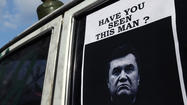 Ukraine interim government issues arrest warrant for Yanukovich