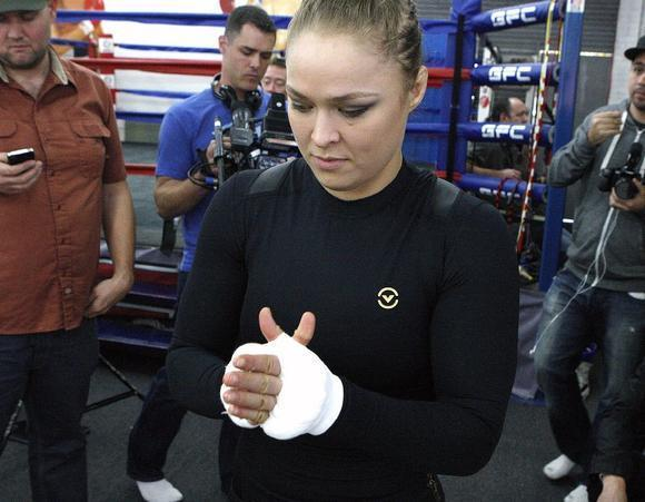 Ronda Rousey, shown here at an open workout on Feb. 10, stayed undefeated with a first-round victory over Sara McMann at UFC 170 on Saturday evening. (Tim Berger/Staff Photographer)
