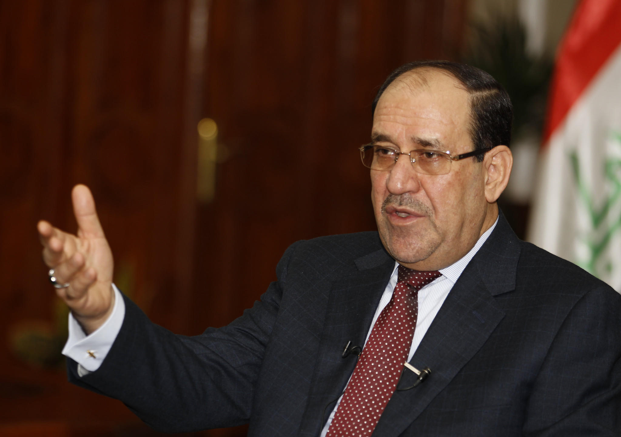 Iraq's Prime Minister Nuri al-Maliki speaks during an interview with Reuters in Baghdad January 12.