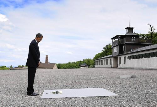 President Barack Obama takes a moment of silence at the Buchenwald concentration camp near Weimar, Germany. Obama's great-uncle, Charles Payne, was among the U.S. soldiers who liberated the nearby subcamp of Ohrdruf in 1945.
