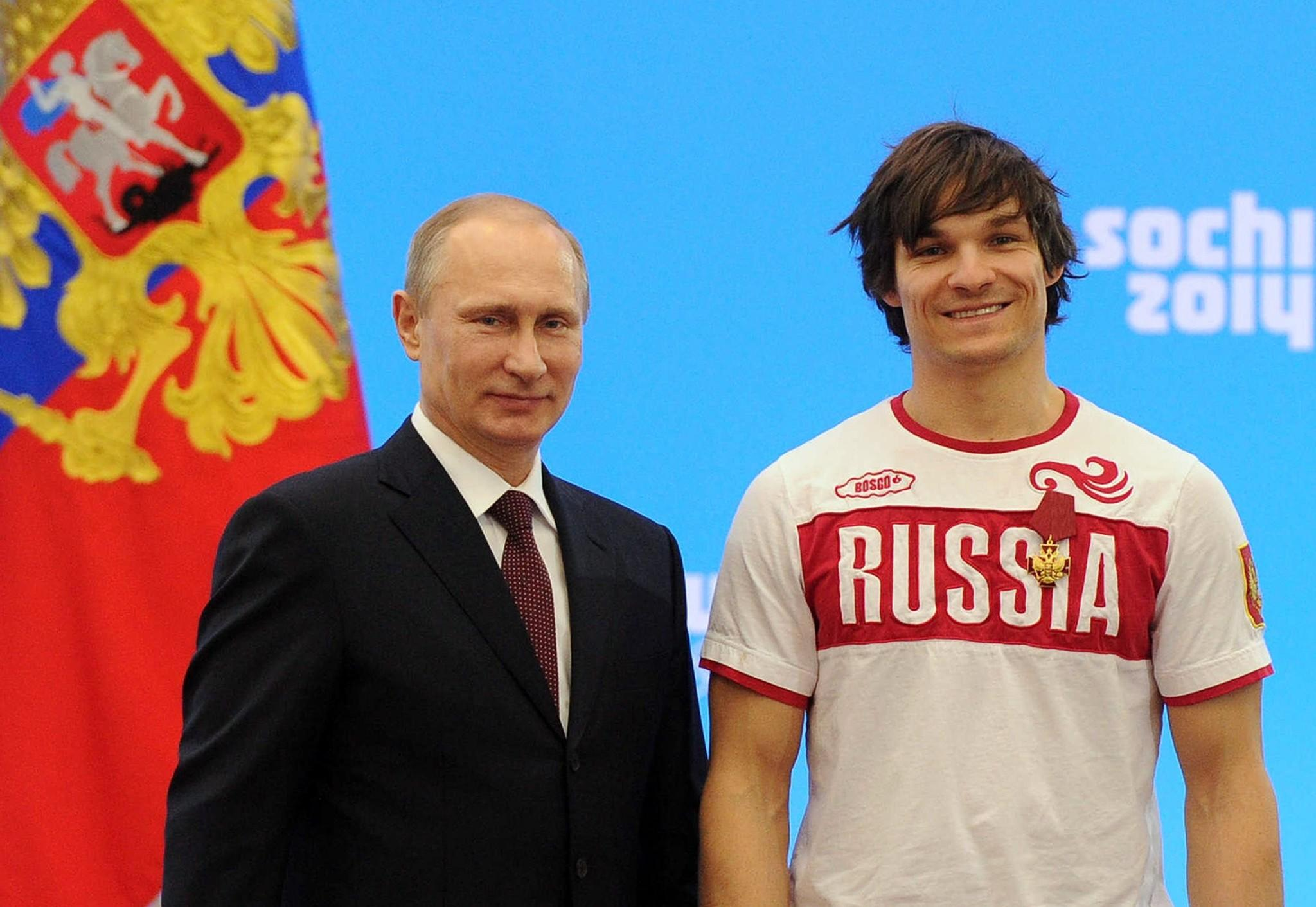 Russia's President Vladimir Putin poses for a photo with U.S.-born snowboarder Vic Wild during an awarding ceremony for Russian athletes Monday.