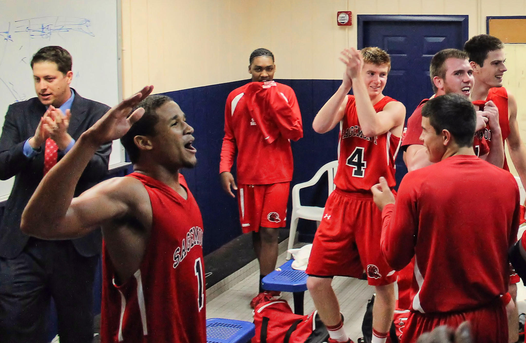 Sagemont coach Adam Ross and his players celebrate after a 91-79 victory over Florida Air Academy.