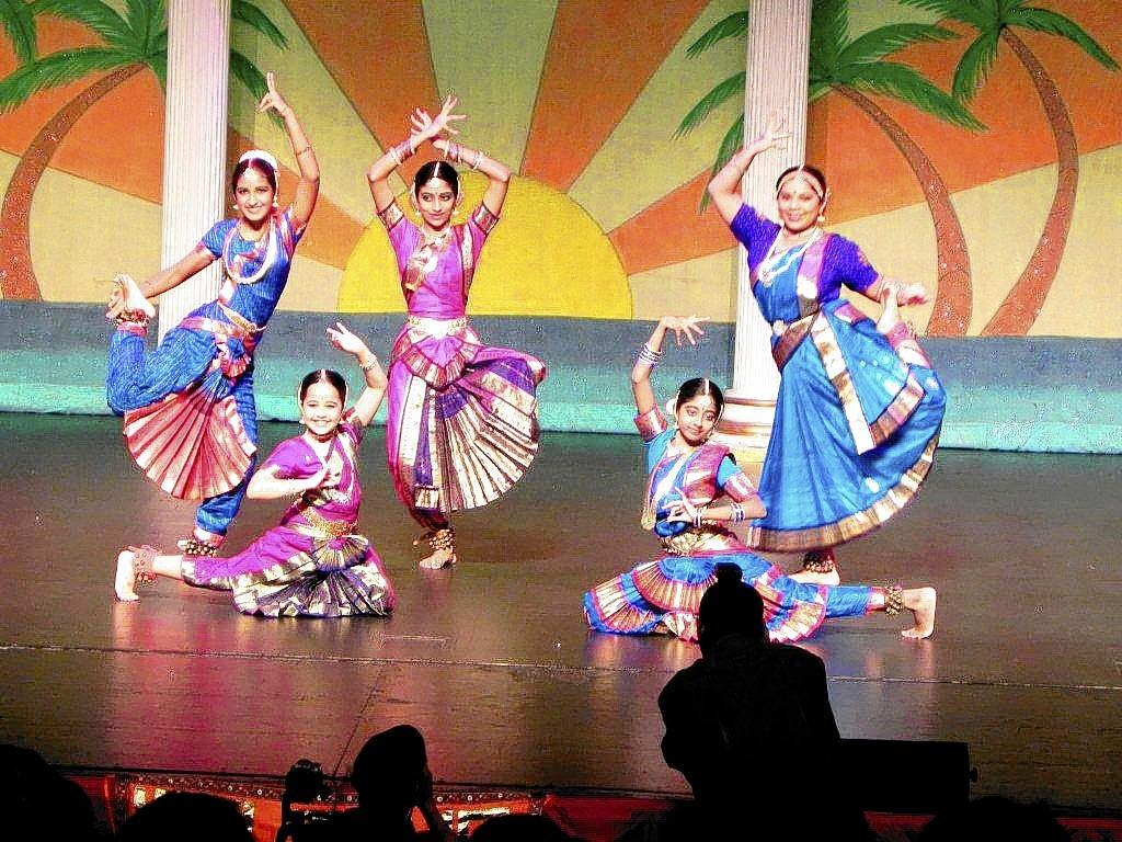 Geometric hand movements and facial expressions distinguish the choreography in performances by students from the Nritya Surabhi School of Dance.
