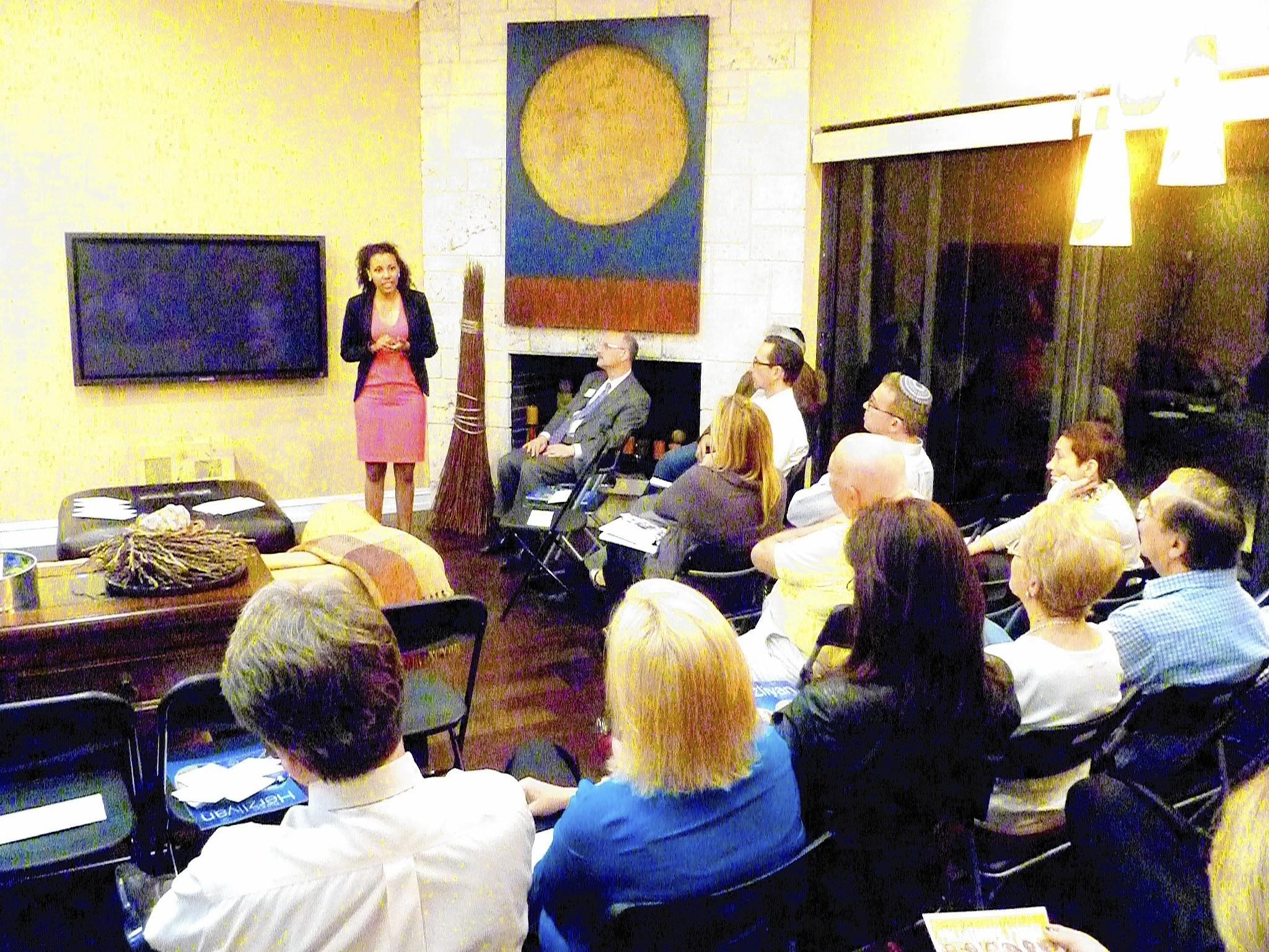 Sarah Tazazo, an Ethiopian-Israeli student at the Interdisciplinary Center Herzliya in Israel, speaks during a program for the Jewish Federation of Broward County's Ethiopian Israeli College Supplemental Fund at a private home in Hollywood.