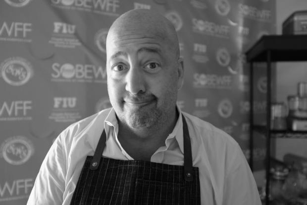 Andrew Zimmern attends KitchenAid Culinary Demonstrations during the Food Network South Beach Wine & Food Festival at Grand Tasting Village on February 23, 2014 in Miami Beach, Florida.