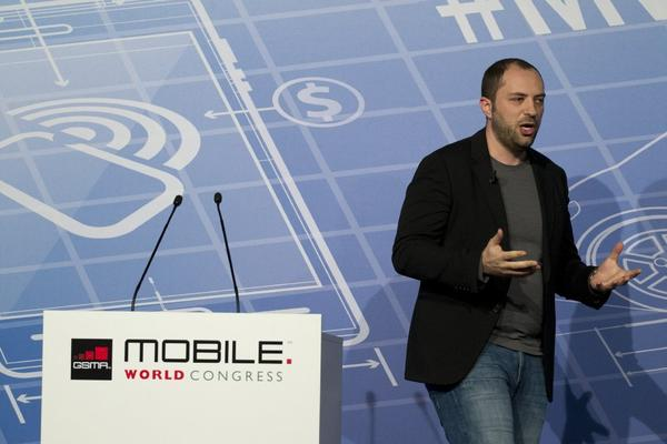 WhatsApp CEO Jan Koum addresses the Mobile World Congress in Barcelona.