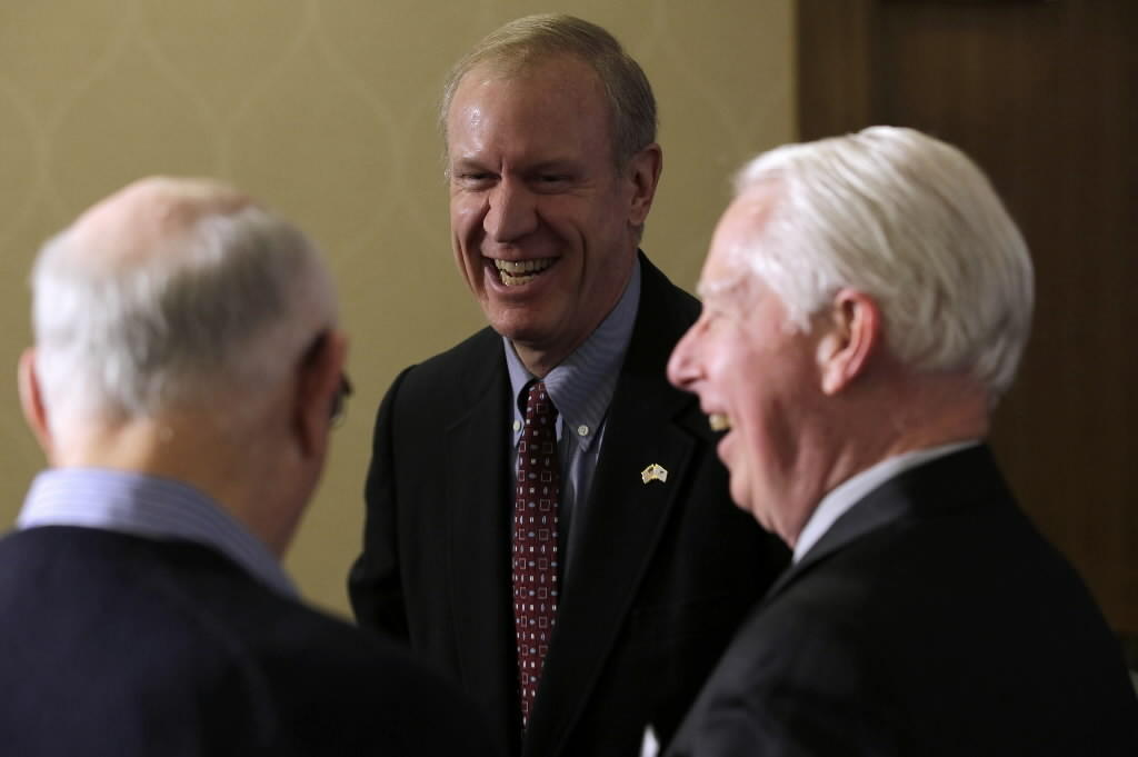 Winnetka venture capitalist Bruce Rauner, seen here at a forum in Naperville this month, has put $5 million of his own money into his bid for the Republican governor nomination.
