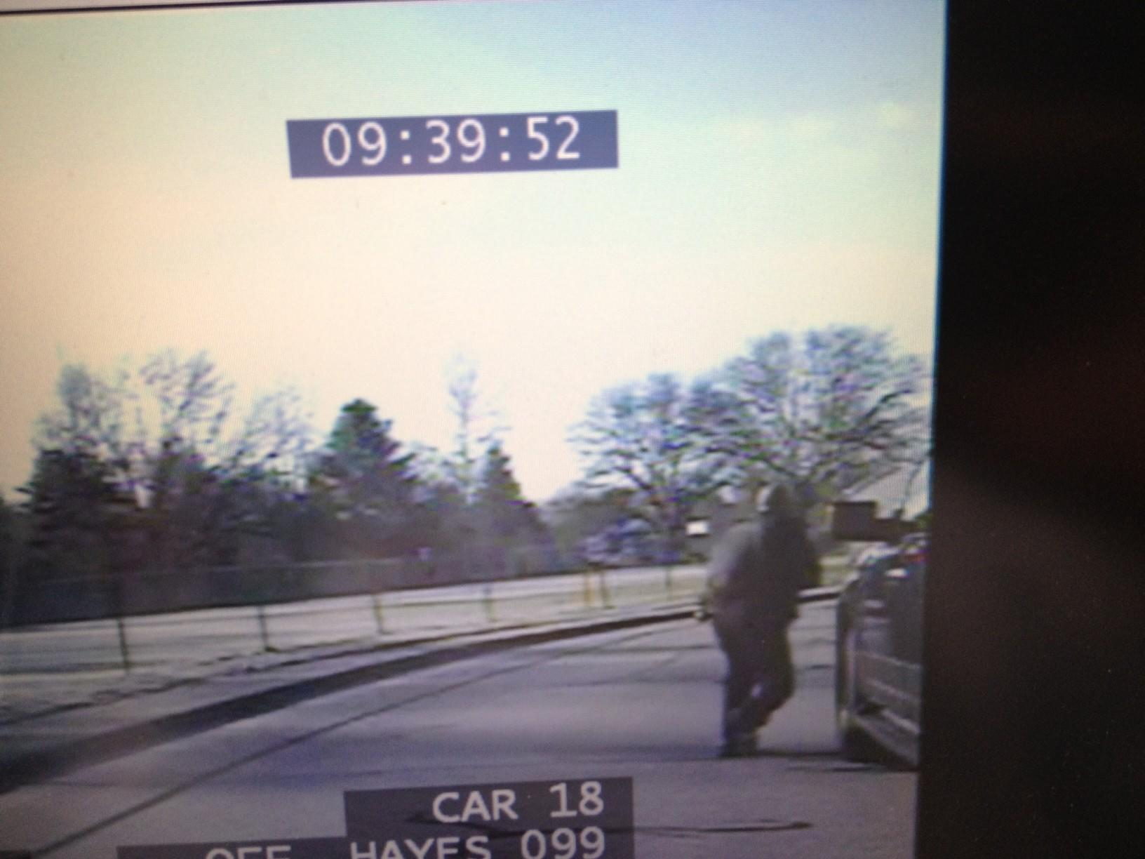 A frame from newly released videos from cameras on cruisers of Newtown officers who responded to the Sandy Hook Elementary School shooting show officers preparing to approach the school.