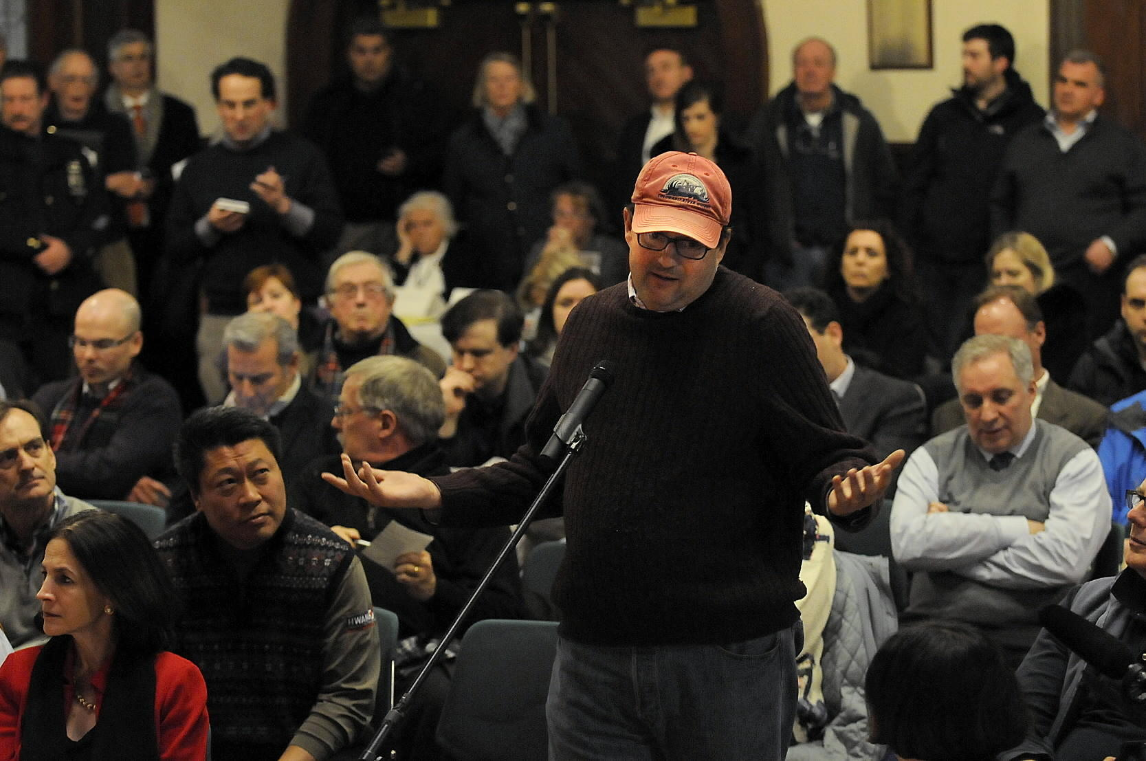Kevin Downey of Fairfield expresses his displeasure with Metro-North during a forum opn Feb. 18 at the Peqout Library in Southport with state Transportation Commissioner James Redeker and John Kesich, senior vice president of operations for Metro-North. The library was packed to capacity.