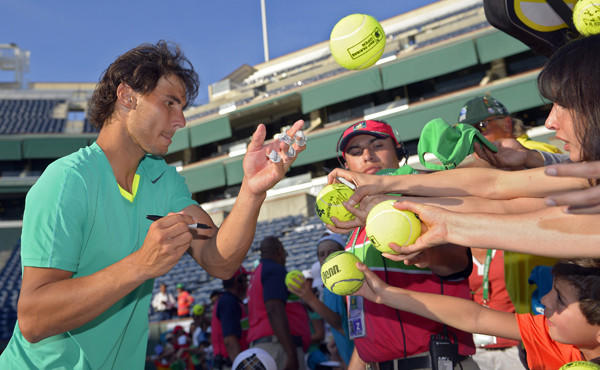 Rafael Nadal signs autographs for fans after winning the BNP Paribas Open in Indian Wells in March 2013. Nadal is among the players who are scheduled to compete in this year's tournament.