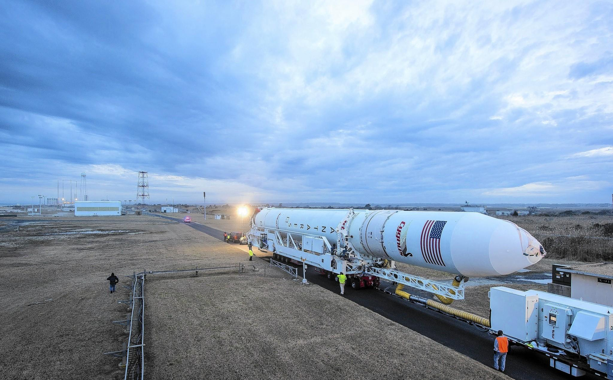 An Orbital Sciences Corporation Antares rocket is rolled out to launch Pad-0A at NASA's Wallops Flight Facility on January 5, 2014 in advance of a planned January 8 launch.