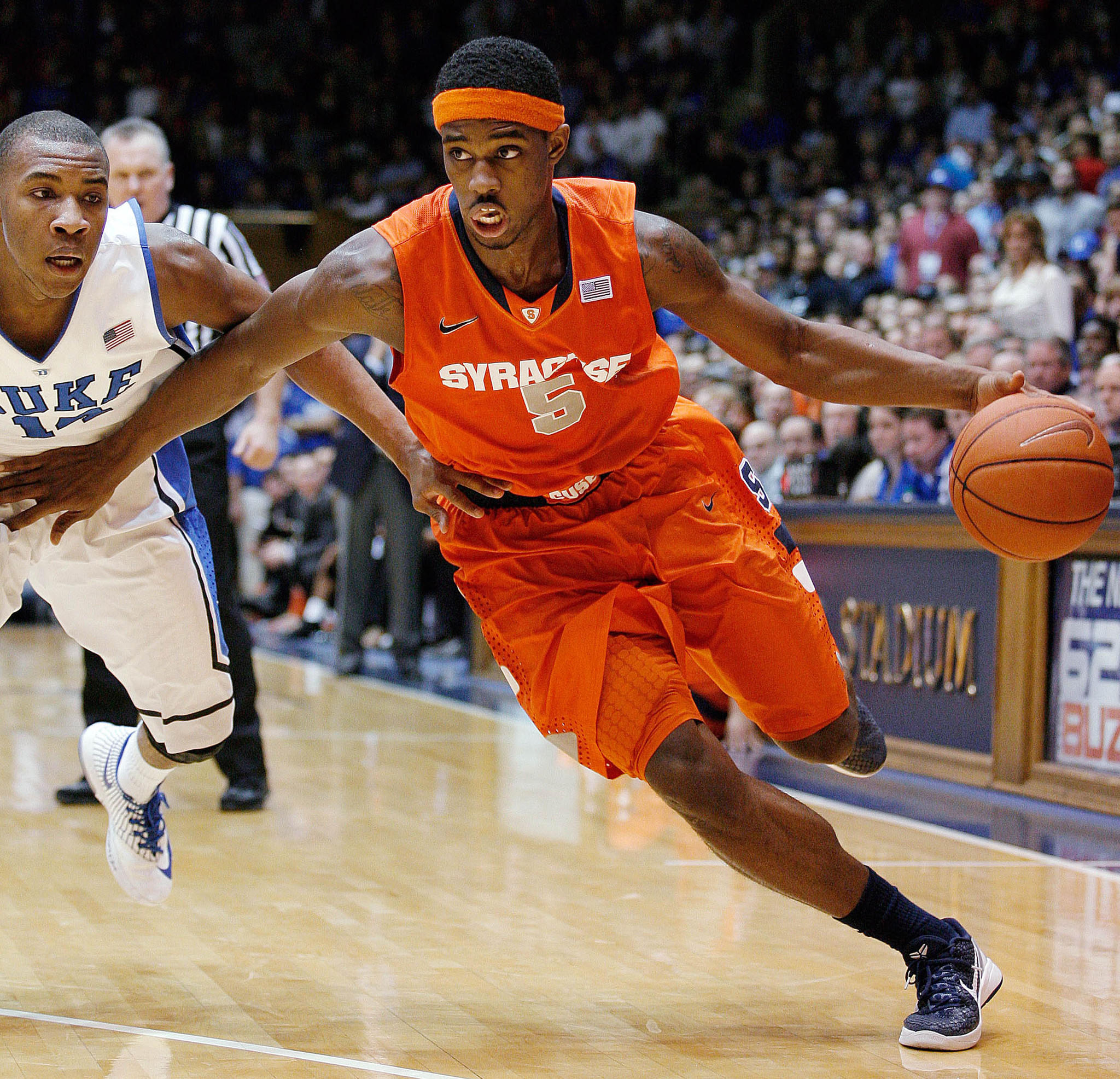 Syracuse's C.J. Fair drives against Duke's Rasheed Sulaimon at Cameron Indoor Stadium.