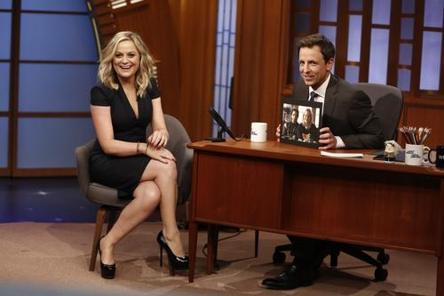 """Actress Amy Poehler laughs with the audience as she is interviewed by Seth Meyers. The funnyman made his debut as host of """"Late Night."""" Poehler and Meyers share a history together that dates back to their days on """"Saturday Night Live."""""""