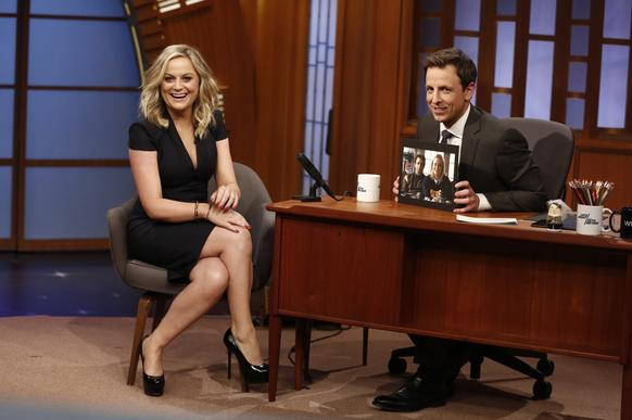 "Actress Amy Poehler laughs with the audience as she is interviewed by Seth Meyers. The funnyman made his debut as host of ""Late Night."" Poehler and Meyers share a history together that dates back to their days on ""Saturday Night Live."""