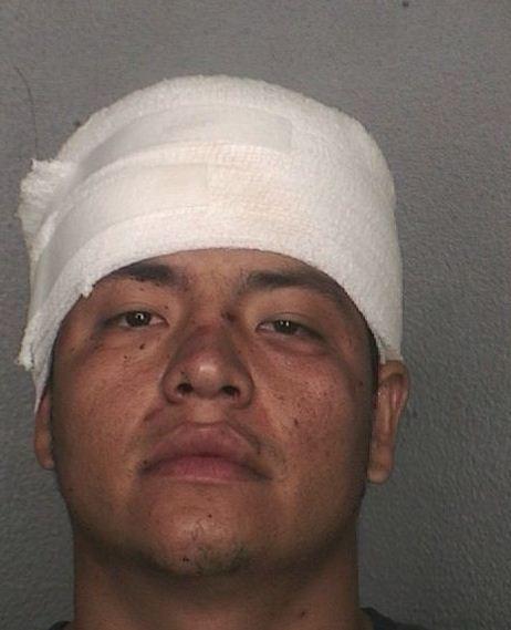 Jony Jesus Saravia, 26, was arrested following a machete-swinging incident at Big Dawgs Sports Cafe in Davie