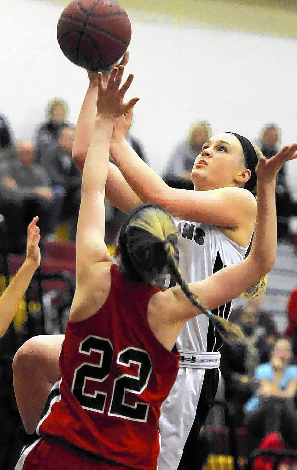 Farmington's Sophie Borg shoots over E.O. Smith defender Holly Worrski in the CCC Girls Basketball Tournament semifinals. E.O. Smith won 59-55 and will play Weaver High in the finals.