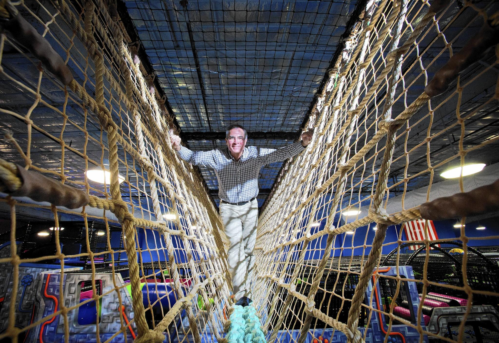 Bruce Roudebush, CEO Galaxy Fun Orlando, stands on one of the rope bridges high above the ground inside of the indoor playground on February 20, 2014. The large indoor playground will be opening later this month.