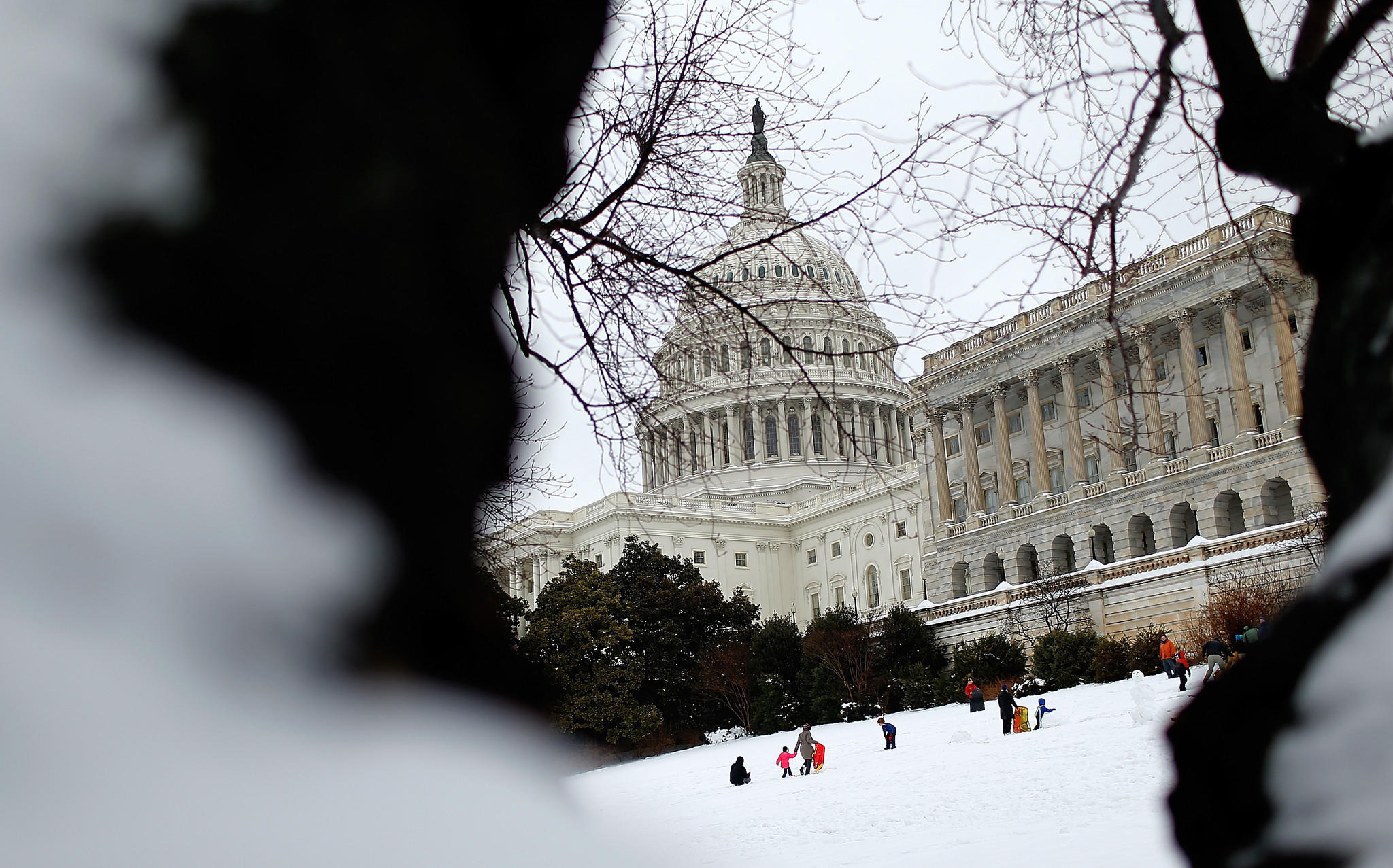 People sled on the west lawn of the U.S. Capitol.